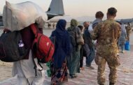 Afghanistan: People at Kabul airport flee Taliban with just a suitcase